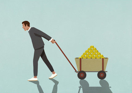 Happy male investor pulling wagon full of gold bars