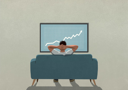Man on sofa watching rising stock market data on TV