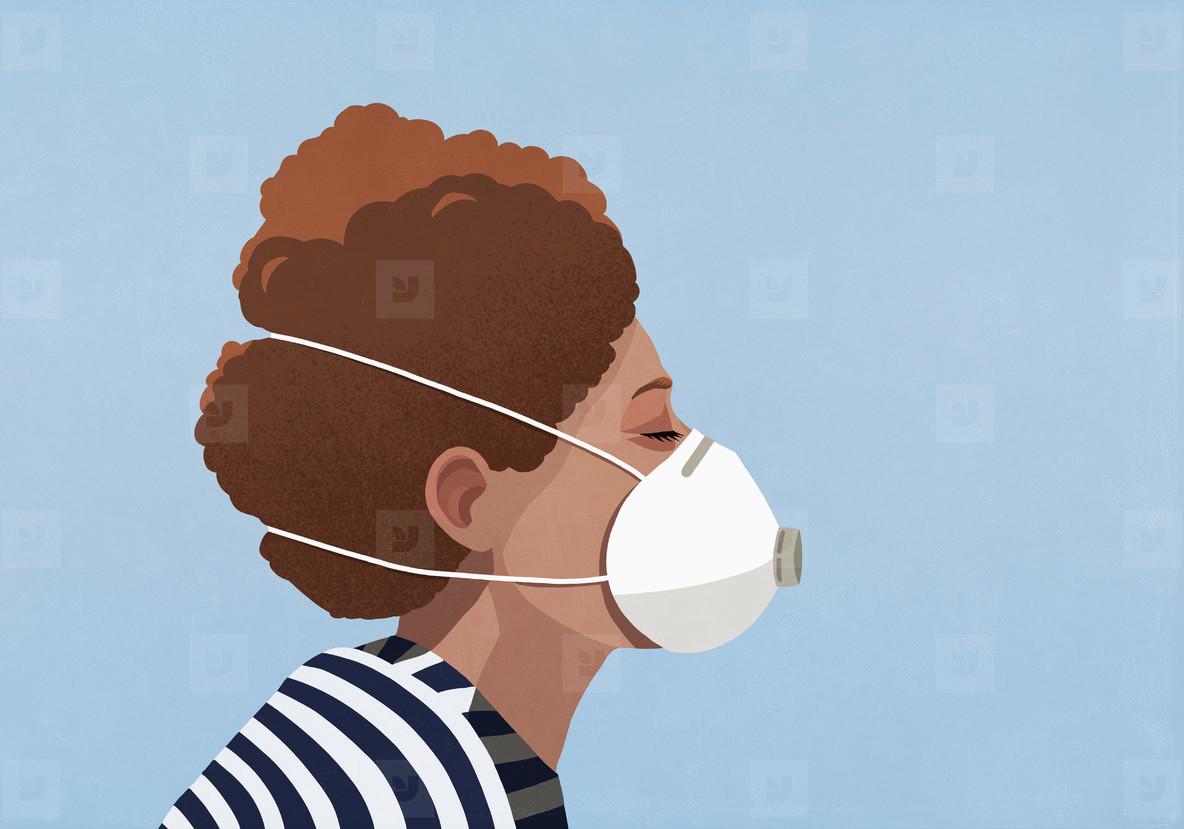 Young woman wearing flu mask