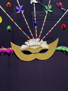 Masquerade mask and pinwheel decorations