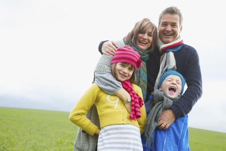 Portrait happy family in grass field