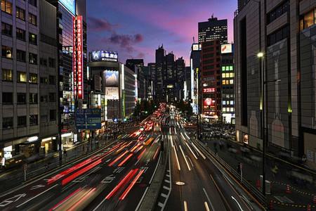 Car light trails on city street