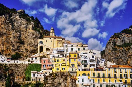 Vibrant buildings among cliffs