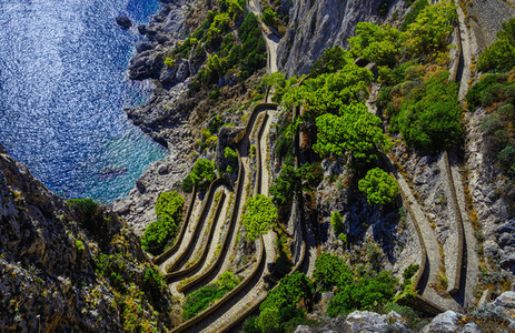 View from above winding cliff path above ocean