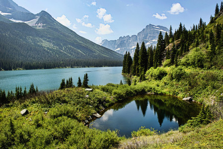 Sunny scenic view mountain lake and inlet