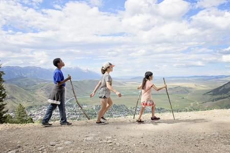 Kids hiking along mountain ridge