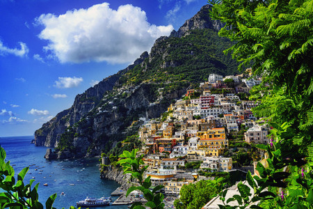 Sunny scenic view Positano among cliffs