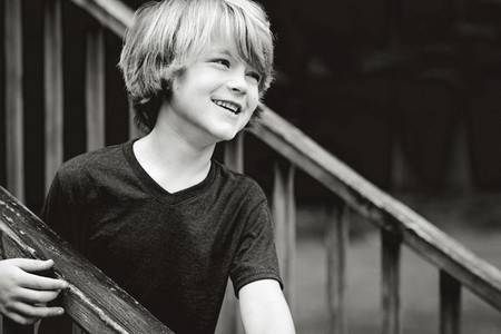 Smiling boy looking away on steps