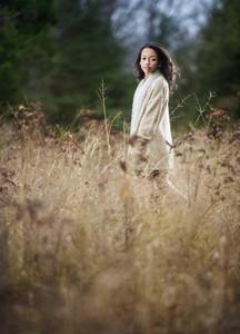Portrait serene girl walking in brush