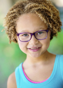 Close up portrait girl with curly hair and eyeglasses