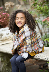 Portrait happy girl in plaid scarf