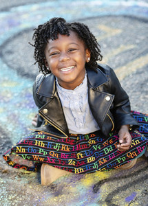 Portrait happy girl in leather jacket