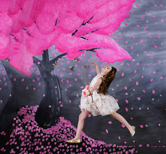 Carefree girl in dress against pink tree backdrop