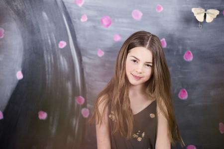 Portrait brunette girl against painted wall