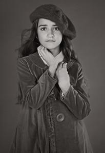 Portrait confident girl in hat and coat