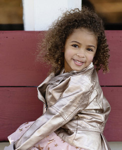 Portrait smiling girl with curly hair