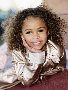 Portrait smiling  confident girl with curly hair