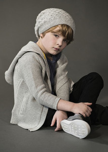 Portrait confident cool boy in knit hat and sweater
