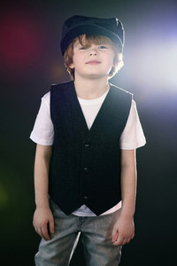 Portrait confident cool boy in cap and vest