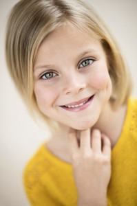 Close up portrait smiling blonde girl