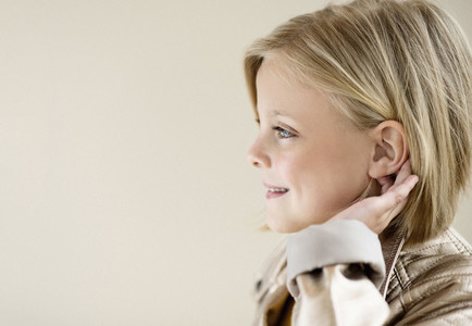 Profile portrait smiling blonde girl looking away