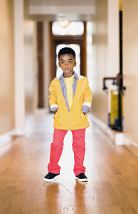 Portrait confident  cool boy in vibrant jacket and pants