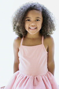 Portrait cute girl in pink dress