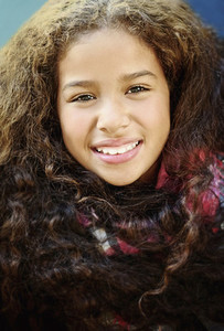 Close up portrait smiling girl with curly black hair