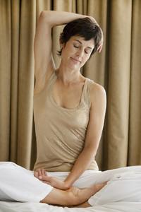 Serene woman stretching