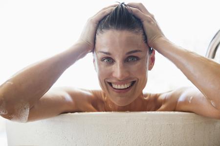 Portrait happy woman enjoying bath