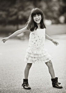 Portrait happy girl in dress and boots