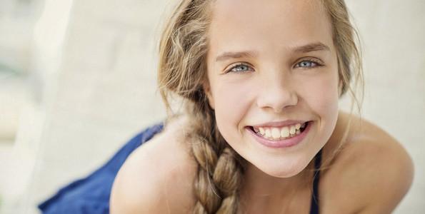 Portrait happy teenage girl with braid