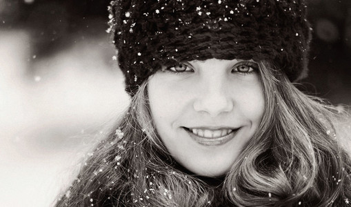 Portrait smiling girl wearing knit hat in snow