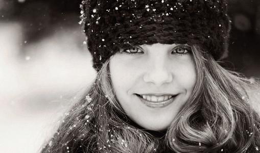 Portrait smiling girl wearing knit hat in snow