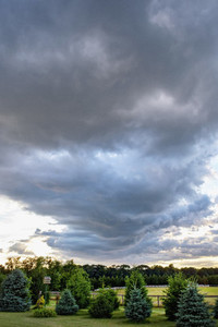 Storm clouds over farmland landscape