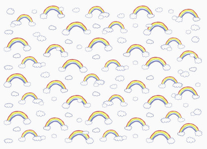 Childs drawing vibrant rainbow and cloud pattern on white background