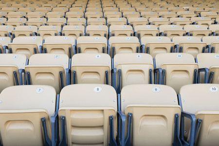 Folding seats in sports stadium