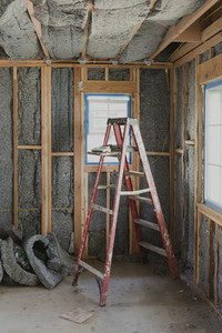 Ladder and insulation in house under construction
