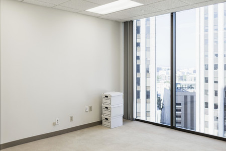 Boxes on floor in empty urban highrise office