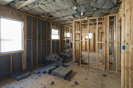 Insulation being installed in house under construction