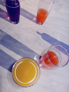 Variety of fruit juices in glasses on table