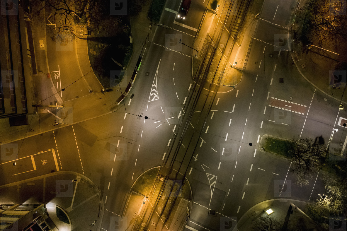 Aerial view empty city streets at night during COVID 19