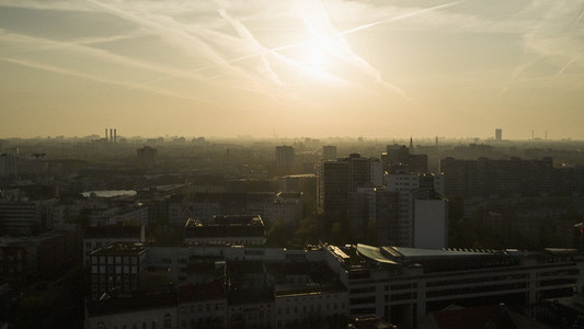 Sunset over silhouetted cityscape