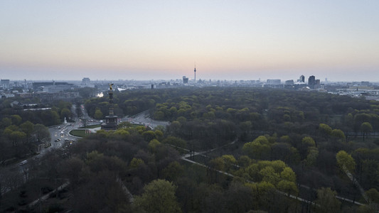 Volkspark Friedrichshain park with view of Victory Column and Berlin cityscape at dusk