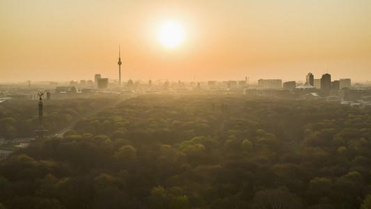 Golden sunset over Berlin cityscape and Volkspark Friedrichshain park