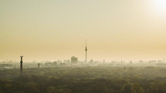 Golden sunset over Television Tower and Volkspark Friedrichshain park