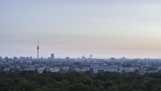 Berlin cityscape and Television Tower beyond Volkspark Friedrichshain park treetops