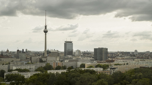 Berlin cityscape and Television Tower under overcast sky