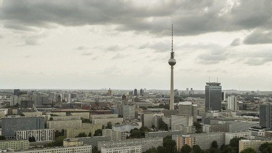 Television Tower and Berlin cityscape under cloudy sky