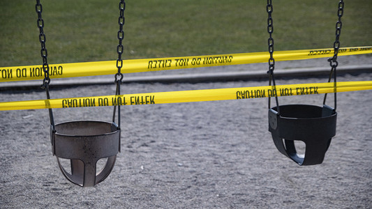 Playground swings taped off during COVID 19 pandemic